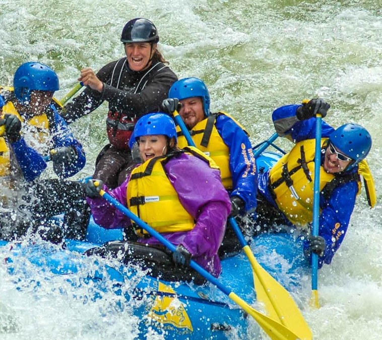 Adults rafting in Colorado