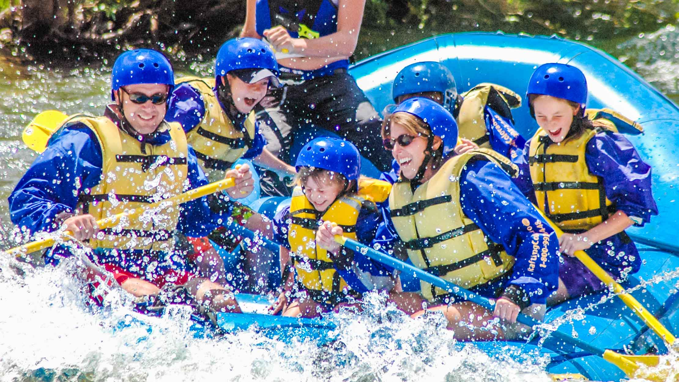 Family rafting through white water